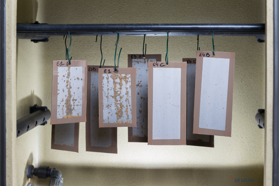 steel samples hanging in a climate chamber Rust prevention additives. Corrosion tests of steels samples in climate chamber